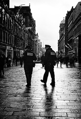 The Beat (Explored) (stephen cosh) Tags: life street leica city people blackandwhite bw sepia mono town candid streetphotography rangefinder leicam7 reallife urbanlife humancondition blackandwhitephotos leicam blackwhitephotos stephencosh