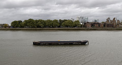 Tidal Thames (The New Motive Power) Tags: city urban reflection london water thames river boat path greenwich peninsula parallel barge canon7d