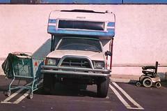 wheels. (howard-f) Tags: urban film analog parkinglot random parking wheels rangefinder ishootfilm grainy pasadena yashicagsn expiredfilm yashicaelectro35 filmisnotdead filmwaster istillshootfilm tokyogratzyparade