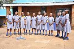 Girls perform a song at Rev Musa Gitau