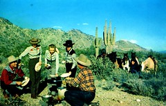 Color Photo Courtesy of American Airlines Tucson AZ (Edge and corner wear) Tags: ranch travel arizona horses southwest tourism cooking coffee sunshine fashion promotion vintage advertising fire pc clothing hands picnic tour desert postcard air models scenic az social tourist compartment wear campfire american western plates saguaro airlines publicity southwestern