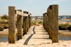 Bridge with beach hut backdrop (Steve M photography) Tags: christchurch beach coast southcoast mudeford hengistburyhead
