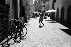 Konstanz - Ilford HP5+ film (Ric Capucho) Tags: city portrait bw white black film rollei analog 35mm photography 50mm switzerland flickr candid zurich grain streetphotography scout snap ilfordhp5 creativecommons analogue unposed tog decisivemoment rollei35 rollei35s primelens lefteyed flickriver streettog skancheli riccapucho