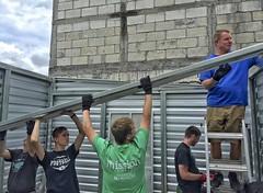 prefab house construction (Pejasar) Tags: prefabricated house construction team workers volunteers project aluminum lift cooperate juntos cruz ayudar