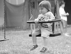 serious baby on the rocking chair (xiaolifra) Tags: bambino altalena dondolo sconosciuto parcogiochi pomeriggio dondolare bambini child children rockingchair swing swinging baby babies unknown sguardoserio serious wary diffidente