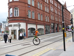 Balancing Act (metrogogo) Tags: mono birmingham ride streetlife streetscene unicycle hugs tramway tramlines wheelie birminghamuk unicyle balancingact monocycle monoman coffeelounge midlandmetro