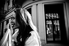 Happiness (stimpsonjake) Tags: city blackandwhite bw monochrome smile happy phone candid joy streetphotography romania bucharest 185mm nikoncoolpixa