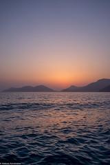 Sea and mountains at the sunset (aleksey_kondratiev) Tags: turkey fethiye oludeniz mediterranean sea water blue wave waves seashore rocks sky sunset mountain