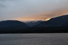 Amber clouds over the Beaufort range (Tynan Phillips) Tags: ocean sunset sea orange cloud sun sunlight mountain seascape canada mountains nature water yellow clouds landscape amber landscapes nikon bc cloudy britishcolumbia canadian denmanisland dslr waterscape d90 oceanscape nikond90