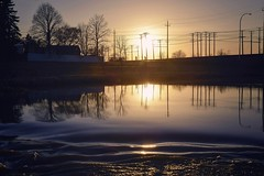 . evening bike ride . (susanonline (busy these days)) Tags: pink blue sunset glass bike creek mirror evening silhouettes swollen telephonepoles bikers riders againstthelight hydropoles susanonline