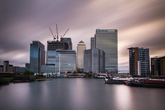Sinister City (jimmypipc) Tags: city longexposure windows sunset sky water glass metal canon buildings sinister metallic transport o2 cranes colourful canarywharf statestreet hsbc barclays finance citi ndfilter 550d