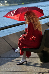 Lady in red (Roving I) Tags: red vertical highheels sydney longhair curls australia circularquay umbrellas whitesocks harbours parasols