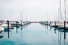 pier in chicago. (Stephanie Pejskar Photography) Tags: sky lake chicago water clouds canon boats pier boat dock cloudy grain chitown windy lakemichigan grainy docking windycity canoneosrebelt2i