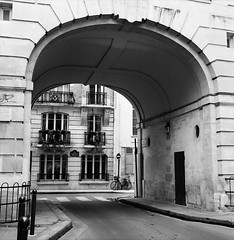 Alley of Saint-Louis (Purple Field) Tags: street bw paris france 120 6x6 tlr film monochrome bicycle analog rolleiflex square alley kodak 400tx medium   f28  schneider kreuznach  80mm    28f  xenotar        stphotographia x