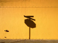 Caution (misterbigidea) Tags: street city shadow urban signs abstract sign yellow wall landscape golden downtown cityscape shadows play view scenic sidewalk stop caution bolt stockton nozzle fragment rivet