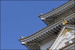 Blue, white, and gold at Osaka-jo (Eric Flexyourhead) Tags: chuoku  osaka  kansai  japan  osakajo  osakacastle castle building architecture blue clear sky traditional japanese roof white gold olympusem5 panasonicdmwma1 50mmmacro20 50mmmacrof20 zd