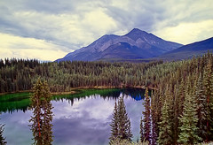 Emerald Lake, NWT Canada (Explore #111) (Matt. Create.) Tags: travel blue trees wild summer vacation sky lake plant canada mountains reflection green nature beautiful pine clouds forest season landscape rockies outdoors high woods scenery solitude view natural top country scenic peaceful nwt calm clean adventure shore recreation wilderness northwestterritories emeraldlake nahanni nahanninp