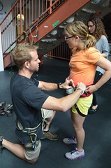 "BELL Participant Faye and our rock climbing guide Keith make sure harnesses are secure. • <a style=""font-size:0.8em;"" href=""http://www.flickr.com/photos/29389111@N07/9541774003/"" target=""_blank"">View on Flickr</a>"