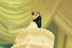 wedding cake (holding onto gravity) Tags: flowers wedding love film smile analog 35mm happy groom bride couple fuji married minolta minoltax700 romantic fujifilm filmcamera x700 proplus proplusii