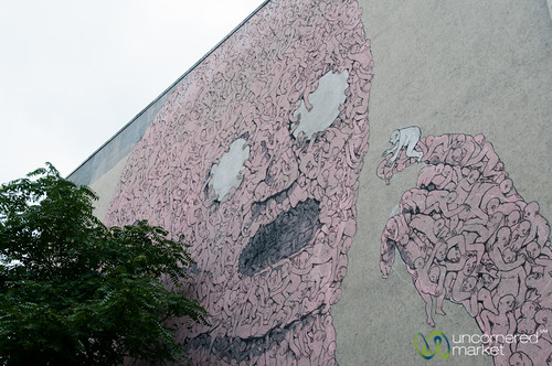 Kreuzberg Street Art, Humans Piece by Blu - Berlin