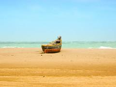 Lonely Boat (Shamu's Photography) Tags: blue sea summer sky india beach water beautiful nikon flickr superb estrellas simply tamilnadu rameswaram autofocus dhanushkodi platinumheartaward nikonflickraward flickrtravelaward