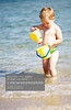 Adorable little boy playing in the sea (creativemarket.photo) Tags: ocean travel family boy sea summer vacation people baby sun playing cute beach nature water beautiful childhood children fun toy outside happy person one freedom coast kid bucket sand child play little joy young lifestyle happiness resort tropical leisure summertime 12 cheerful dig wateringcan swimwear caucasian wateringpot