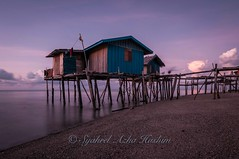 Long exposure of houses on stilts. (Syahrel Azha Hashim) Tags: ocean longexposure morning travel light vacation holiday detail beach colors clouds sunrise island nikon colorful dof getaway details naturallight nopeople tokina malaysia slowshutter shallow simple dramaticsky residential sabah fishingvillage sandybeach ultrawideangle semporna housesonstilts d300s syahrel rarecation