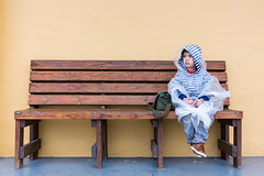 Sitting on a Wooden Bench (About Two Boys and a City) Tags: miamitrip everglades alligator waiting wooden bench woodenbench raincoat poncho boy