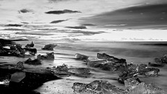 and here ends their millenial existence (lunaryuna) Tags: ocean longexposure sky beach sunrise landscape coast iceland le jokulsarlon northatlantic diamondbeach naturalabstract glacialice southeasticeland glacialicefloes