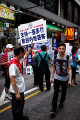 P5220208 Strange smile with members of pro-government organization (Scofield Chan) Tags: street 35mm hongkong snapshot olympus streetphoto mongkok 17mm streetsnap politicalissue