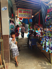 Boy in marketplace, Nauta, Iquitos, Peru. (okaystephanie) Tags: life street travel boy peru sign amazon day culture daily mercado marketplace iquitos amazonas peruvian nauta