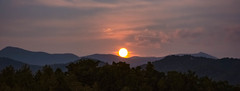 Once in a lifetime:  A strawberry moon (bankst) Tags: trees mountains nature clouds nikon fullmoon moonrise firstdayofsummer rare westernnorthcarolina strawberrymoon rosemoon lowinsky ambercolor summersolice highhumidity meadmoon d7200 risesfully risesalmostfullyilluminated