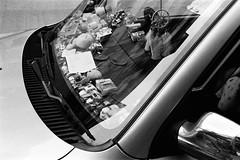 Micro-macro (klolam) Tags: blackandwhite film window glass monochrome car 35mm hongkong lomography pentax decoration analogue pentaxmesuper