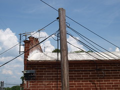 Communications Network at the County Bus Shop (Fred Watkins (kg4vln)) Tags: kg4vln olympus e420 antennas telephonewires busshop houstoncounty communications camminante blue sky redbrick telephonepole puffyclouds