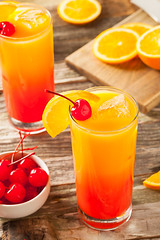 Juicy Orange and Red Tequila Sunrise (brent.hofacker) Tags: red party summer orange white cold color ice beach glass yellow fruit bar sunrise cherry frozen juicy cool mixed drink sweet juice beverage decoration tequila fresh cocktail liquor drinks slice alcohol tropical syrup rum citrus alcoholic refreshing liquid fruity freshness garnish refreshment ingredient tequilasunrise grenadine