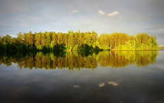 Evening reflections (yooperann) Tags: county light lake clouds reflections golden evening swan bass michigan symmetry upper peninsula mute marquette gwinn