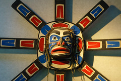 Mask (Carrie Cole Photography) Tags: wood old travel red canada abstract art history tourism face vancouver design coast wooden carved ancient colorful paint bc mask pacific northwest bright symbol native outdoor britishcolumbia indian traditional rustic culture first craft totem columbia pole american sacred british poles tradition aboriginal nations totems craftsmanship carriecole