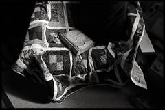 28th of February 2016 (Paul of Congleton) Tags: family blackandwhite home monochrome childhood digital book chair sony diary livingroom domestic february throw 2016 myeverydaylife rx100