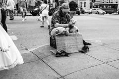 Desperation on Michigan Avenue (Phil Roeder) Tags: chicago illinois michiganavenue blackandwhite leica leicax2 homeless