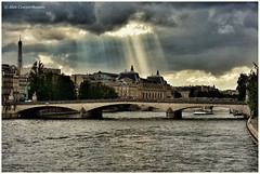 The sun very occasionally finds a hole in the clouds (alcowp) Tags: paris france tourism weather seine clouds river unesco sunbeams orsaymuseum