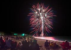 Beachside Spectacular (PopsDigital) Tags: blue red sky white color colour reflection beach water festival night harbor glare bright fireworks firework rocket burst spectators july4th 4thofjuly independenceday wi kewaunee billpevlor popsdigital sonyslta77v