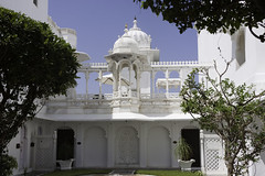 Open area inside the Lake Palace hotel in Udaipur with the marble structure and greenery (Ashish A) Tags: trees sky india building grass architecture canon asia arch decoration bluesky carving dome dslr canondslr fresco digitalslr carvings heritagebuilding rajasthan udaipur historicalbuilding lakepalacehotel canoncamera lakepichola heritagehotel luxuryhotel canoneos50d historicalstructure tajlakepalacehotel heritagestructure