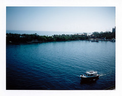 Leaving Nassau (Brock5604) Tags: ocean cruise carnival blue trees summer vacation sky film water port polaroid leaving island pier boat dock paradise fuji bright outdoor sunny sound tropical instant bahamas nassau