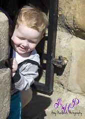 Dylan (AmyNewlandsPhotography) Tags: park boy castle sunshine child peekaboo portraiture