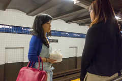 Holding Bags (rockerlan) Tags: newyork train subway photo holding candid sony jackson roosevelt queens bags avenue heights rx100