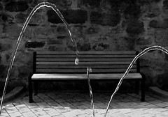 I Sat By The Ocean (Anthony Pallotto Photography) Tags: city urban bw white black water fountain wall germany bench concrete flow outdoors bavaria town ni