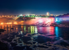 Niagara Falls at Night (Philipp Klinger Photography) Tags: new york longexposure trip travel bridge blue light shadow vacation sky orange usa ny ontario canada color colour reflection fall nature water yellow rock stone skyline night america skyscraper reflections river dark landscape flow lights niagarafalls us waterfall nikon rocks colorful stream long exposure purple shot nightshot state bright united von vivid niagara falls cliffs american hour swirl states bluehour colourful amerika philipp current drift kanada on staaten klinger vereinigte of d700 dcdead