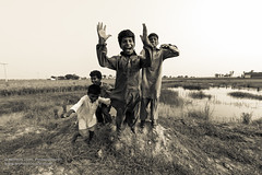 excitement and childhood.jpg (Mohsin Jamil Photography) Tags: pakistan summer blackandwhite fish love water childhood kids rural children jump peace village rice mud traditional lifestyle dirty soil heat laugh fields punjab excitement punjabi dirtywater sheikhupura