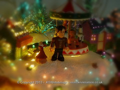 The Doctor in the snow merry go round