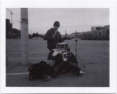 Drum Solo (Polaroid SF) Tags: sanfrancisco blackandwhite polaroid drummer missionbay expiredfilm